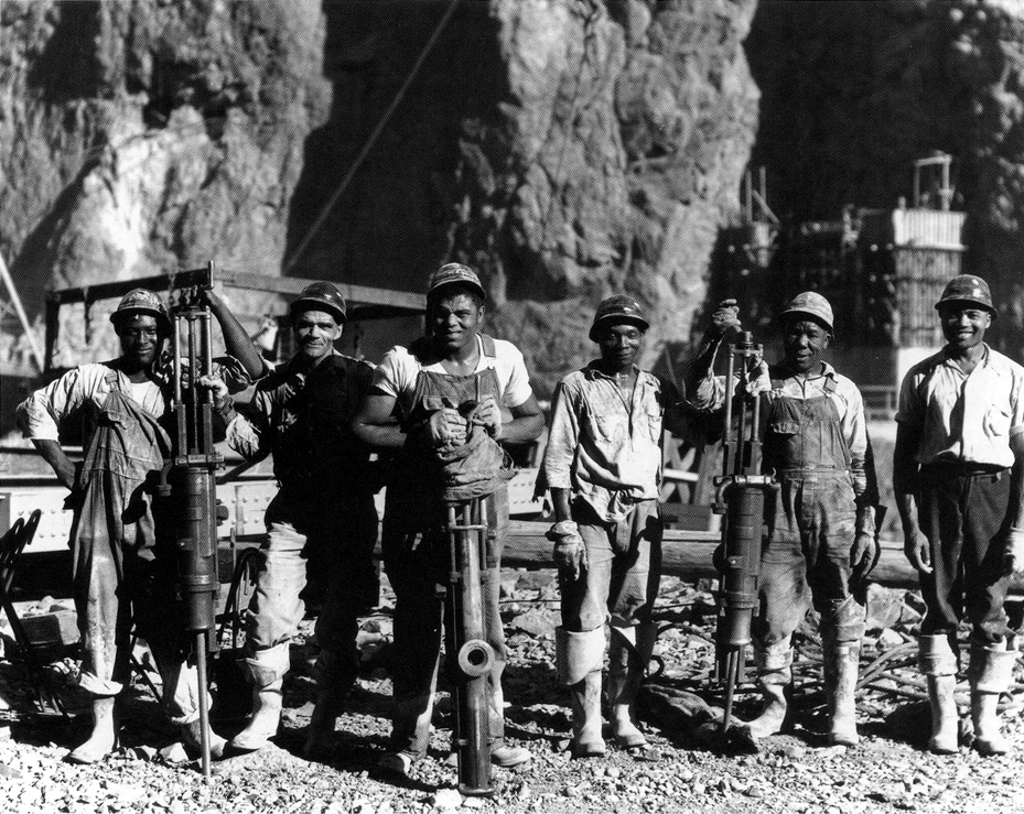 1932, unpublished Bureau of Reclamation photograph of African-Americans working at the dam. According to some scholars, this photo was likely staged and then kept on file to guard against charges of racial discrimination.