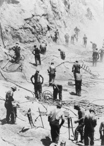 1933 05-01 - Drillers Work on Nevada Side Excavating the Dam